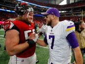 Defensive end Brooks Reed talks to Case Keenum after an NFL game between the Atlanta Falcons and Minnesota Vikings