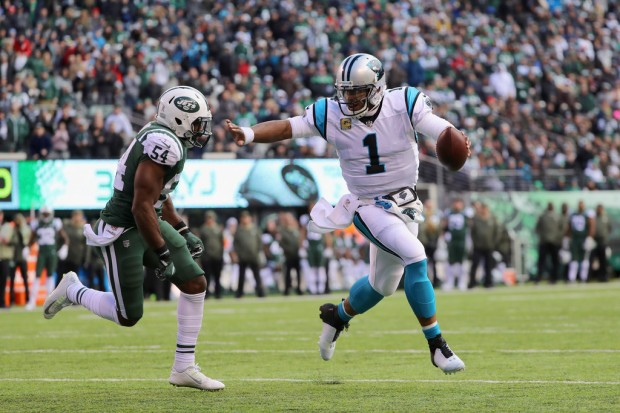 Linebacker Bruce Carter — seen here as a member of the New York Jets — attempts to tackle Cam Newton against the Carolina Panthers