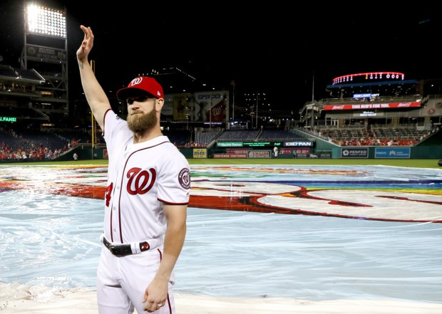 Former Washington Nationals outfielder Bryce Harper waves to the crowd after his final home game of the 2018 season against Miami Marlins