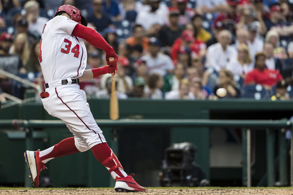 Former Washington Nationals star Bryce Harper hits an RBI double against the New York Mets