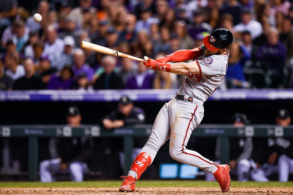 Former Washington Nationals outfielder Bryce Harper hits a seventh inning single against the Colorado Rockies