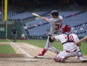Former Washington Nationals outfielder Bryce Harper hitting an RBI single against the Philadelphia Phillies