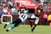 Former Carolina Panthers cornerback Captain Munnerlyn attempts to tackle Jordan Reed against the Washington Redskins