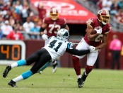 Former Carolina Panthers cornerback Captain Munnerlyn attempts to tackle Jordan Reed against the Washington Redskins