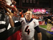 Quarterback Case Keenum celebrates with the fans after the Broncos defeated the Arizona Cardinals