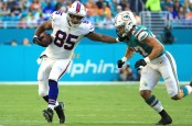 Former Buffalo Bills tight end Charles Clay stiff arms Kiko Alonso against the Miami Dolphins