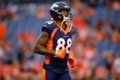 Former Denver Broncos wide receiver Demaryius Thomas stands on the field during warmups before a game with the Kansas City Chiefs