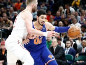 Former New York Knicks center Enes Kanter dribbles the ball against the Indiana Pacers defender