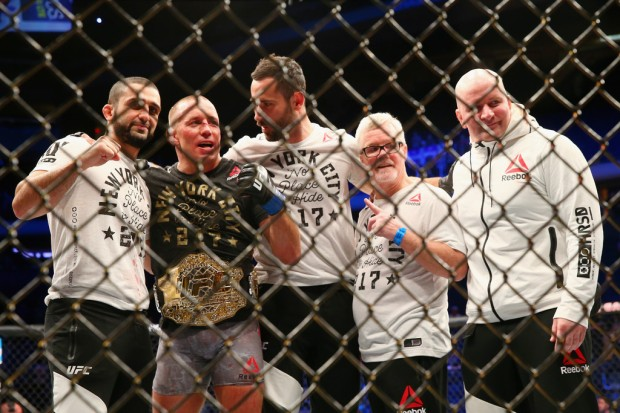 MMA fighter Georges St-Pierre with the UFC Middleweight belt after defeating Michael Bisping during the UFC 217 event
