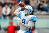 Salt Lake Stallions quarterback Austin Allen attempts a pass against the Birmingham Iron