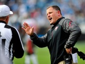 Former Tampa Bay Buccaneers head coach Greg Schiano looks for answers on a call against the Detroit Lions