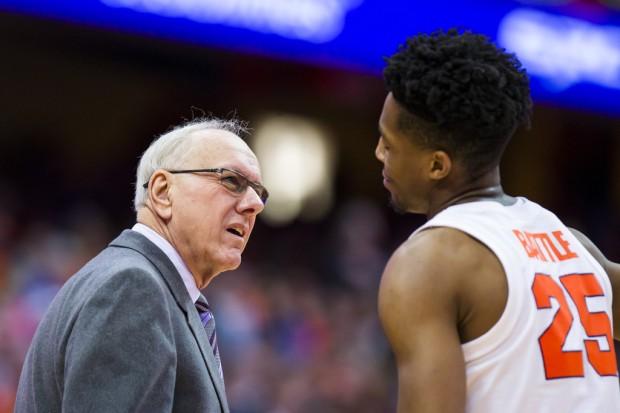 Syracuse Orange men's basketball coach Jim Boeheim speaks to Tyus Battle against the Buffalo Bulls