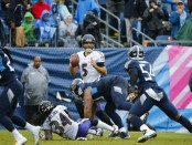Former Baltimore Ravens quarterback Joe Flacco attempting a pass against the Tennessee Titans