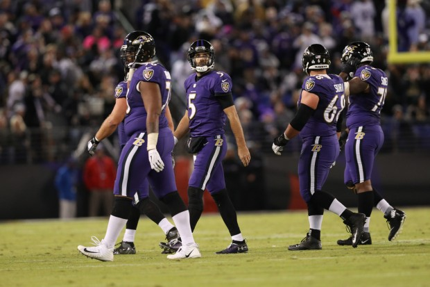 Former Baltimore Ravens quarterback Joe Flacco walking off the field in the fourth quarter against the New Orleans Saints