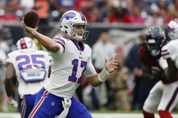 Buffalo Bills quarterback Josh Allen attempts a pass against the Houston Texans