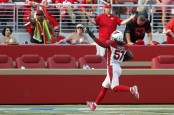 Arizona Cardinals linebacker Josh Bynes celebrates scoring a touchdown against the San Francisco 49ers after sacking C.J. Beathard