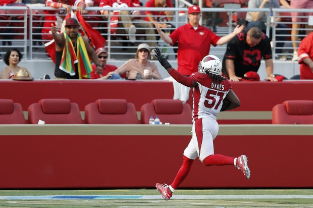 Arizona Cardinals linebacker Josh Bynes celebrates scoring a touchdown against the San Francisco 49ers after sacking C.J. Beathard