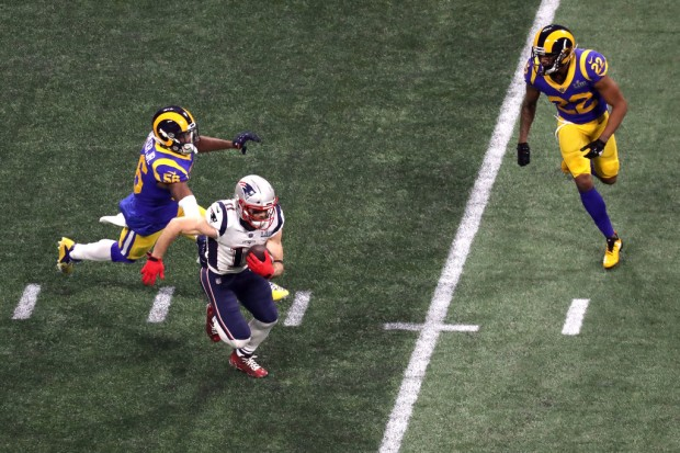 New England Patriots wide receiver Julian Edelman runs with the ball against the Los Angeles Rams in Super Bowl LIII