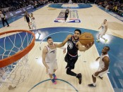 Minnesota Timberwolves center Karl-Anthony Towns of Team LeBron shoots against Team Giannis in the 2019 NBA All-Star Game