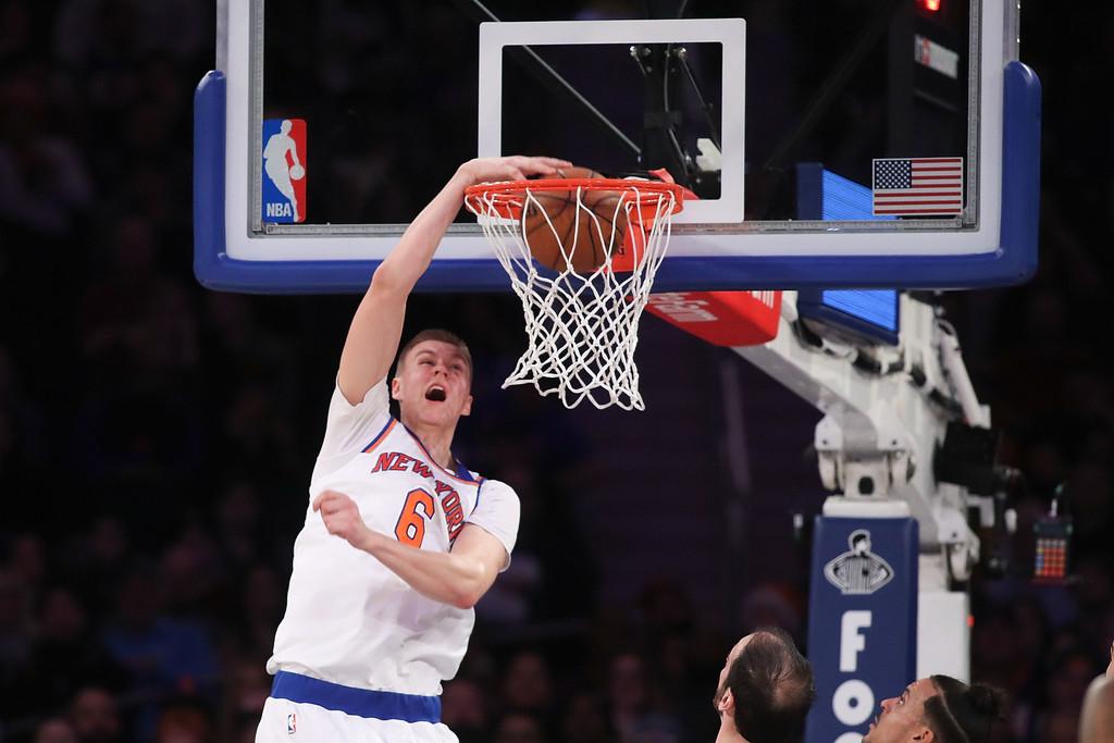 Newly acquired Dallas Mavericks forward Kristaps Porziņģis slams down a dunk against the Sacramento Kings