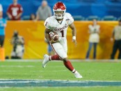 Former Oklahoma Sooners quarterback Kyler Murray running the ball in the Capital One Orange Bowl against the Alabama Crimson Tide in the 2019 College Football Playoff Semifinal