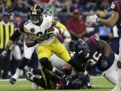 Former Pittsburgh Steelers running back Le'Veon Bell rushing the ball against the Houston Texans