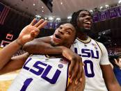 LSU Tigers basketball players Javonte Smart and Naz Reid celebrates after defeating No. 5 Tennessee Volunteers