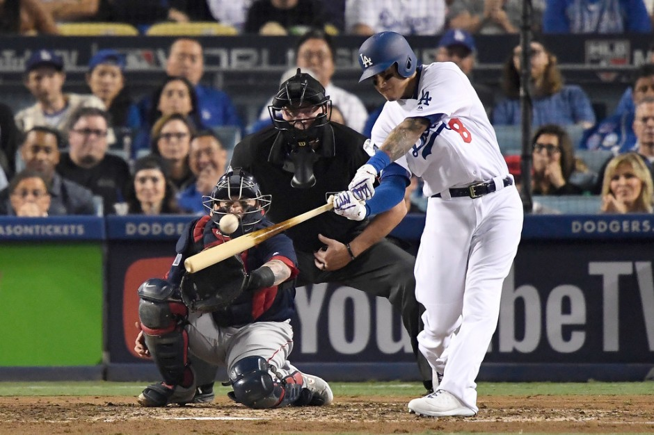 Former Los Angeles Dodgers third baseman Manny Machado hits a single against the Boston Red Sox in the 2018 World Series