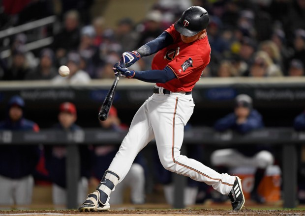 Minnesota Twins outfielder Max Kepler hits an RBI single against the Chicago White Sox