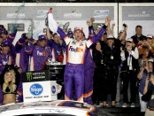 Denny Hamlin celebrates in Victory Lane after winning the Monster Energy NASCAR Cup Series 61st Annual Daytona 500 at Daytona International Speedway