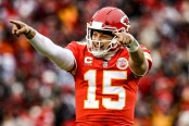 Kansas City Chiefs quarterback Patrick Mahomes II points to the sidelines to celebrate a touchdown pass against the Indianapolis Colts