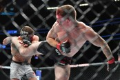 MMA fighter Paul Felder kicks Mike Perry at UFC 226
