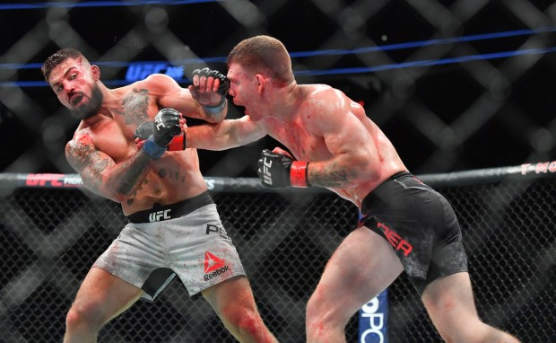 MMA fighter Paul Felder throws a punch against Mike Perry at UFC 226