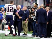 New England Patriots owner Robert Kraft talks to star Tom Brady on the field before Super Bowl LIII