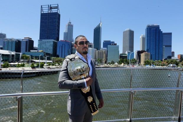 UFC fighter Robert Whittaker poses with his belt at the UFC 221 Perth Workouts