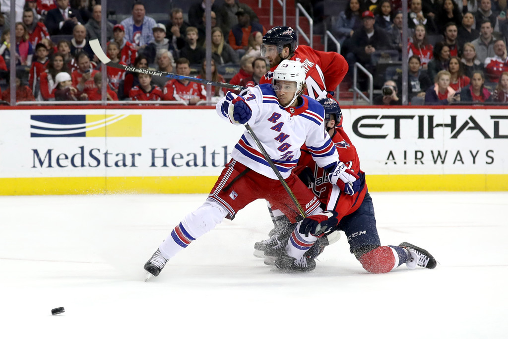 Former New York Rangers center Ryan Spooner looses control of the puck against the Washington Capitals