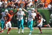 Miami Dolphins quarterback Ryan Tannehill hands the ball off to Kenyan Drake against the Cincinnati Bengals