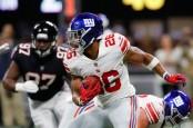 New York Giants running back Saquon Barkley rushing the ball against the Atlanta Falcons