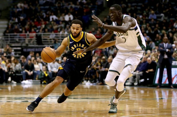 Former Milwaukee Bucks center Thon Maker defending Cory Joseph against the Indiana Pacers