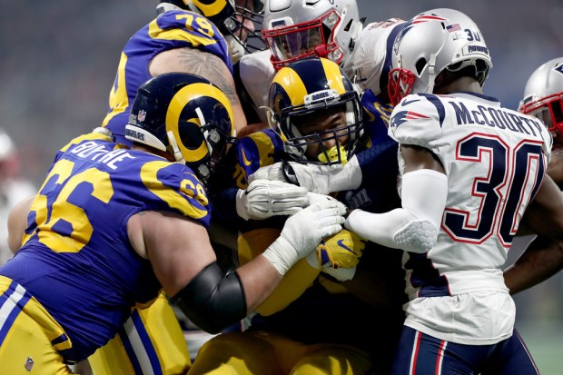 Los Angeles Rams running back Todd Gurley rushing the ball against the New England Patriots in Super Bowl LIII
