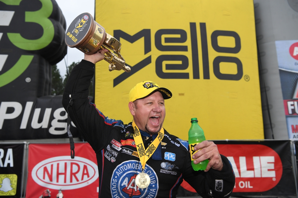 Funny Car pilot Robert Hight with his Wally after winning the 2019 Amalie Motor Oil NHRA Gatornationals