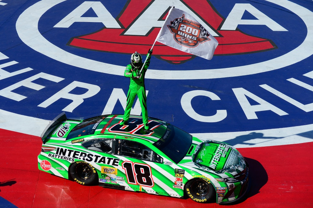 Driver Kyle Busch celebrates winning the Monster Energy NASCAR Cup Series Auto Club 400