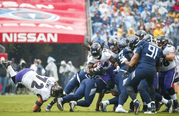 Former Baltimore Ravens running back Alex Collins rushing the ball against the Tennessee Titans