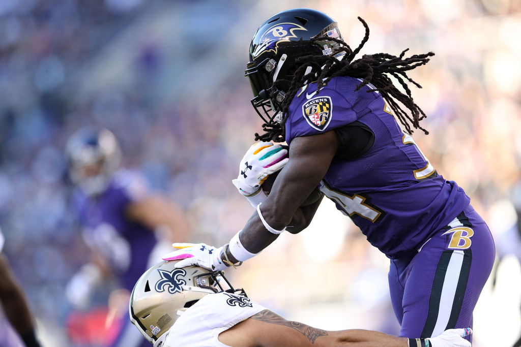 Baltimore Ravens running back Alex Collins carries the ball against the New Orleans Saints