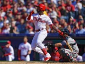 Philadelphia Phillies outfielder Andrew McCutchen hits a home run against the Atlanta Braves in his first at-bat on Opening Day