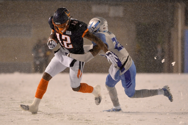 Orlando Apollos wide receiver Charles Johnson is tackled by Will Davis against the Salt Lake Stallions