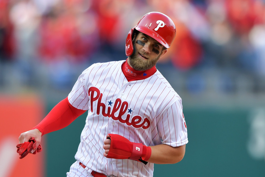 Philadelphia Phillies outfielder Bryce Harper rounding the bases after Rhys Hoskins hit a grand slam against the Atlanta Braves in the season-opener