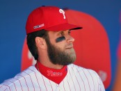 Philadelphia Phillies slugger Bryce Harper stands in the dugout before the game with the Atlanta Braves