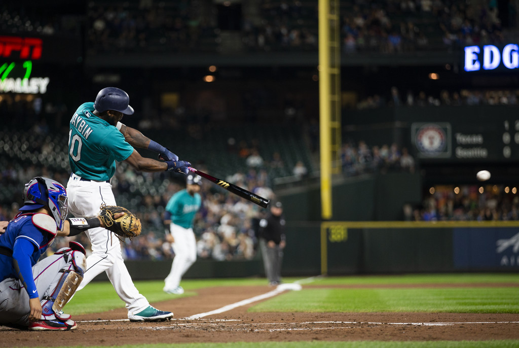 Former Seattle Mariners outfielder Cameron Maybin hits a single that scored Nelson Cruz against the Texas Rangers