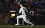 Former Colorado Rockies outfielder Carlos Gonzalez reacts after hitting a triple against the Milwaukee Brewers in the 2018 NLDS